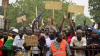 Opposition supporters in Burkina Faso's capital, Ouagadougou, demand that President Blaise Compaore gives up power (18 January 2014)