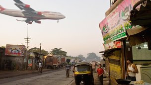 Air India passenger plane flies low over Jari Mari slum, Mumbai