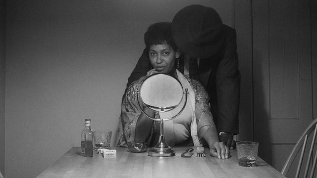 Carrie Mae Weems and a man in her Kitchen Table series