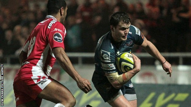 Scarlets' Steffan Hughes runs in for his side's first try