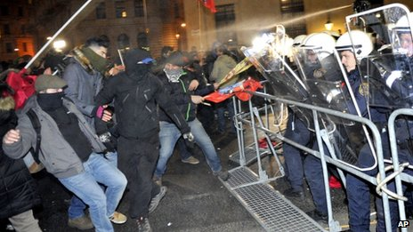 Demonstrators are stopped by police as they gather to oppose a ball being hosted at the Hofburg palace by the right-wing FPOE party, Friday, 24 January, 2014, in downtown Vienna, Austria