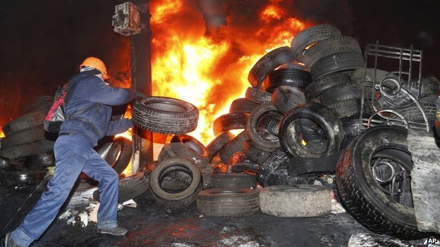 Protesters at a new barricade in Kiev, 24 January