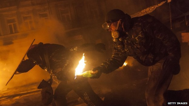 Anti-government protesters attack police near Dynamo Stadium in Kiev, Ukraine, on 24 January