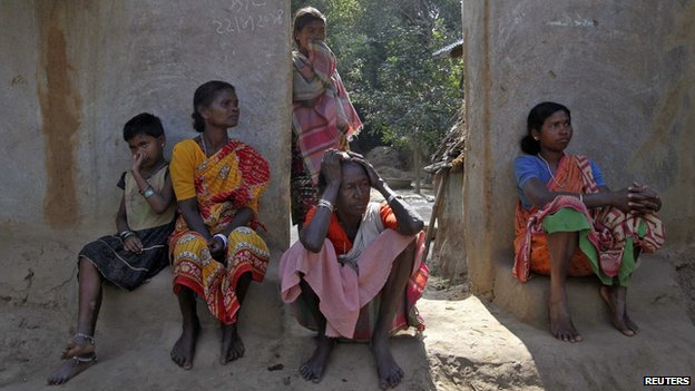 Villagers sit near the area where a woman was gang-raped at Birbhum district in the eastern Indian state of West Bengal (January 24, 2014)