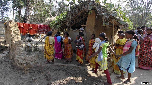 Villagers walk near the area where a woman was gang-raped at Birbhum district, in the eastern Indian state of West Bengal (January 24, 2014)