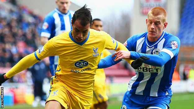 Wigan goalscorer Ben Watson in action against Crystal Palace's Marouane Chamakh at the DW Stadium