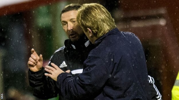 Derek McInnes and Stuart McCall exchange words during the 2-2 draw.