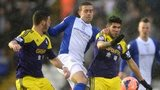 Birmingham's Olly Lee battles for the ball with Swansea's Alejandro Pozuelo