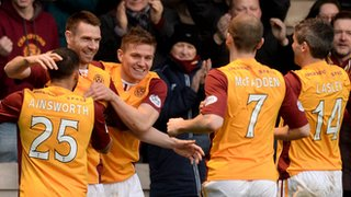 Stephen McManus celebrates with teammates after his header put Motherwell 1-0 up at Fir Park