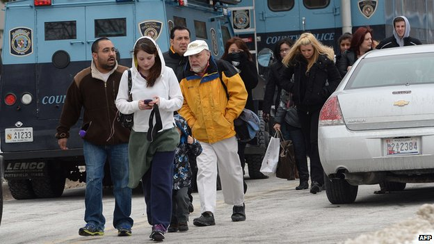Shoppers are evacuated after a fatal shooting at Columbia Mall on January 25, 2014, in Columbia, Maryland