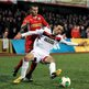 Cliftonville's Martin Donnelly moves in to challenge Crusaders midfielder Declan Caddell