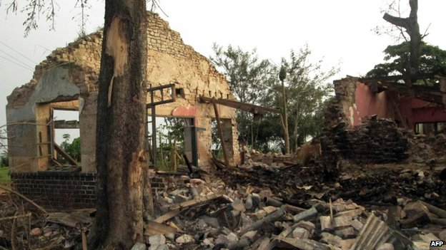 View of a house destroyed at the Camp Brigade after an explosion at an arms depot in Mbuji-Mayi, the central Democratic Republic of Congo, on 25 January 2014