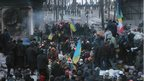 Protesters gather at a barricade at the site of clashes with riot police, Kiev (25 Jan)