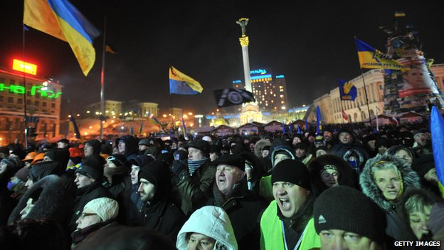 Anti-government supporters gather on Independence Square following the talks between opposition leaders and Ukrainian President Viktor Yanukovych in Kiev on 25 January 2014.