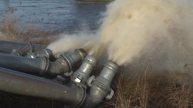 Flood water being pumped into a river