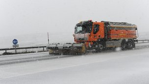 A snow plough makes its way along the A66 as hill snow falls in the Northern Pennines