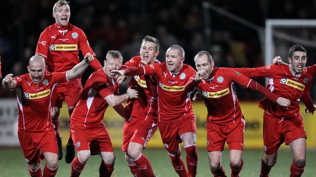 Cliftonville players celebrate their penalty shoot-out win over Crusaders