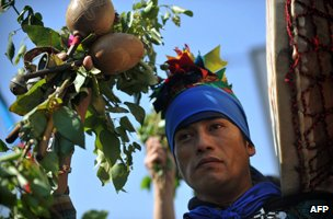 A Mapuche indigenous man marches during a protest for the commemoration of Columbus Day in Santiago