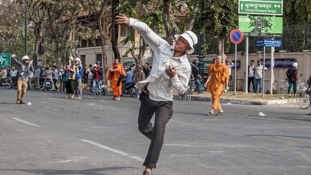Protester throwing stones in Phnom Penh
