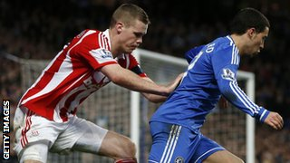 Eden Hazard is challenge by Ryan Shawcross