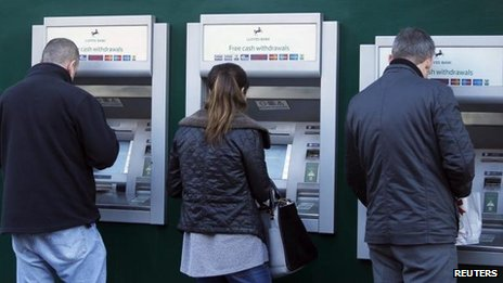 People using Lloyds Bank cash machines