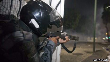 Anti riot police officers fire rubber bullets after clashes in Rio de Janeiro, Brazil, in June 20, 2013