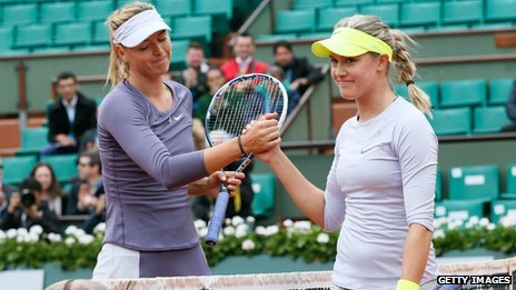 Russia's Maria Sharapova (L) shake hand with Canada's Eugenie Bouchard after winning their French Open match in May 2013