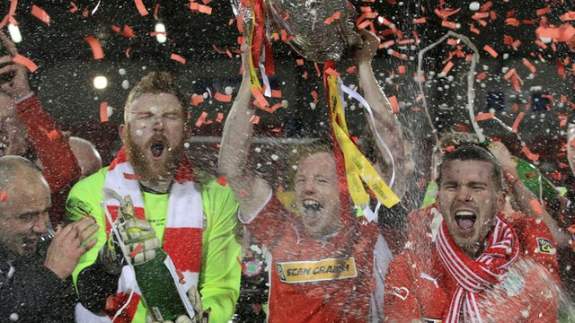 Cliftonville players celebrate winning the League Cup at Solitude