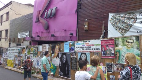 The facade of the Kiss nightclub, now covered with pictures and banners