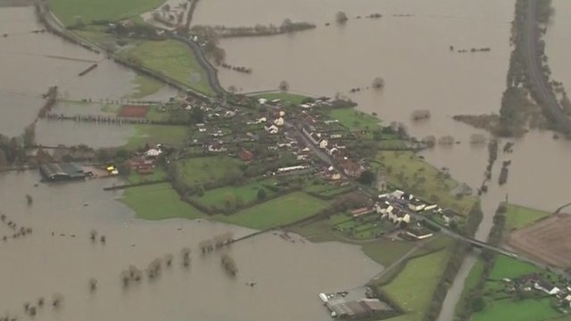 Aerial view of houses surrounded by water