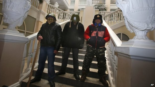 Protesters stand guard inside the Justice Ministry in central Kiev, January 27