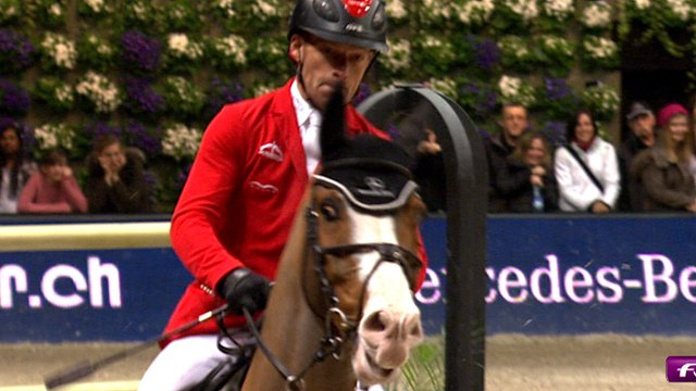 Pius Schwizer of Switzerland claims victory in the Zurich qualifying round of the Longines FEI World Cup.