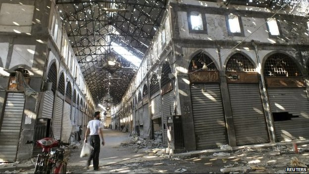 A man walks through the souk in the Old City of Homs (20 August 2013)
