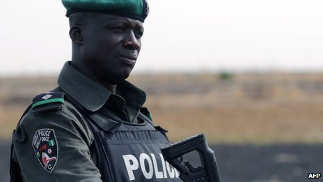 A Nigerian policeman patrols with Nigerian soldiers in the north of Borno state (file image)