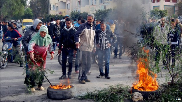 Residents of Kasserine in western Tunisia burn tyres during a protest on 2 January 2013