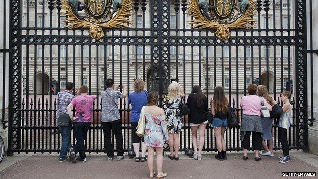 Tourists stood outside Buckingham Palace gates