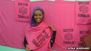 Ilwad Elman with the Sister Somalia logo
