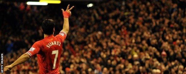 Luis Suarez celebrates scoring against Hull at Anfield