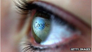 An eye with Google logo reflection