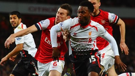 Liverpool's Daniel Sturridge is challenge by Laurent Koscielny of Arsenal