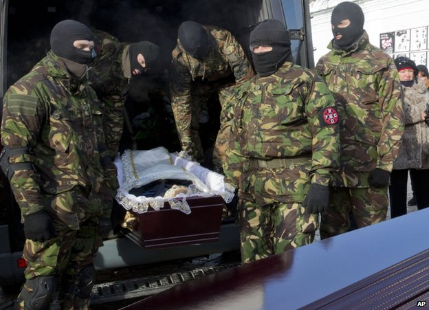 The paramilitary funeral of shooting victim Mikhail Zhyznewski in Kiev, 26 January