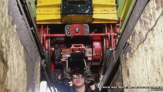 Engineer works on train in Car Depot