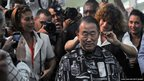 UN Secretary General Ban Ki-moon having his hair cut, surrounded by photographers in Cuba on 27 January