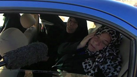Umm Ahmed, a heavily pregnant woman, and her female companions at a checkpoint entry to Karbala province, Iraq