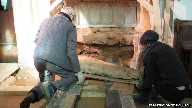 The tomb being removed