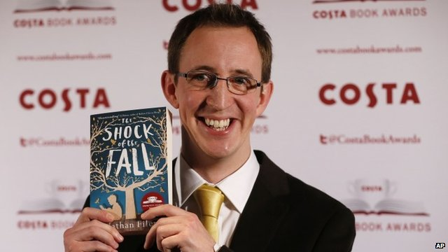 Nathan Filer with his book The Shock of the Fall