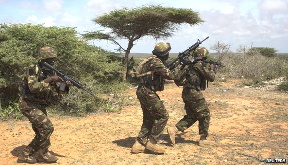 Kenya Defence Forces (KDF) Rangers secure an area during a foot patrol on the outskirts of the controlled area of the old airport in the coastal town of Kismayo(November 2013)