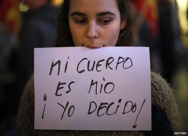A pro-choice protester in Malaga, southern Spain, 27 December 2013