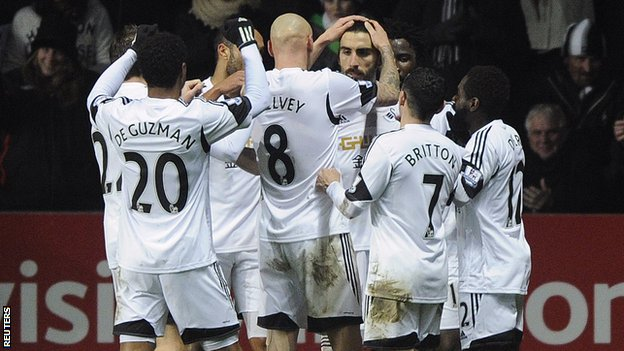 Swansea City celebrate Chico's second goal against Fulham