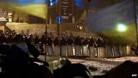 Riot police face protesters in Kiev. 28 Jan 2014